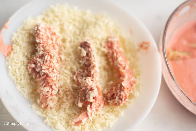 coating the mushrooms with bread crumbs