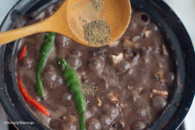 seasoning the vegan dinuguan with pepper