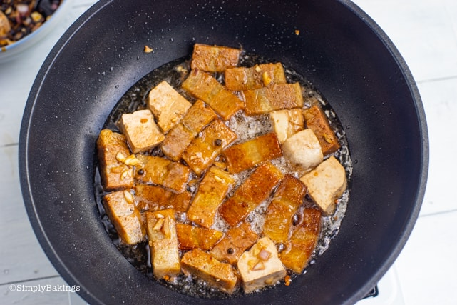 frying the vege meat and tofu for the vegan humba recipe