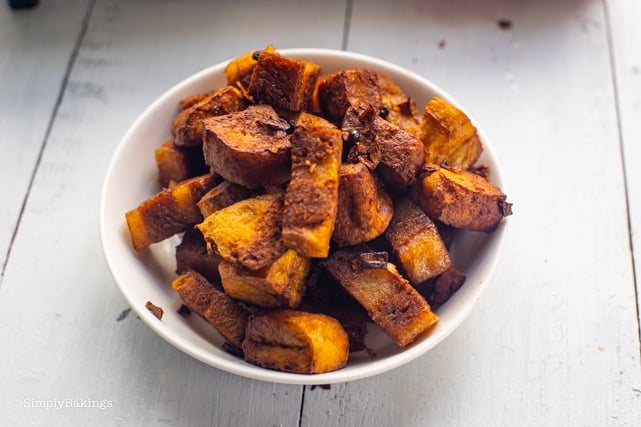 golden brown vege meat and tofu in a white bowl
