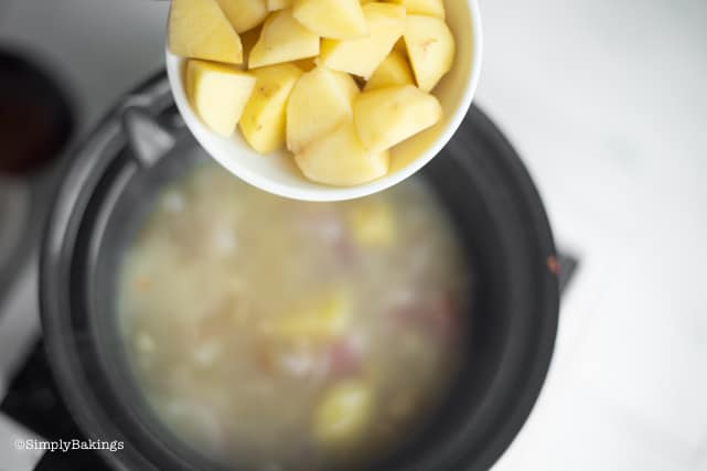 adding the potatoes to the simmering vegetables