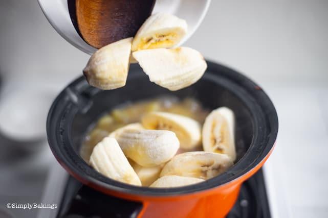 adding saba bananas to the simmering vegetables for the Vegan Pochero recipe