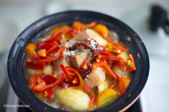 seasoning with salt, pepper and adding the bell pepper to the simmering vegetables