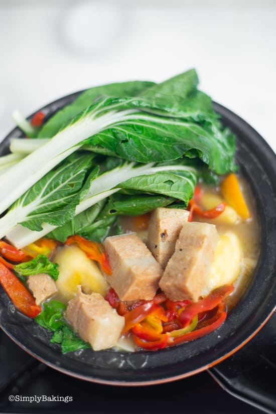 vegan pochero in a pot loaded with delicious vegetables and vege meat