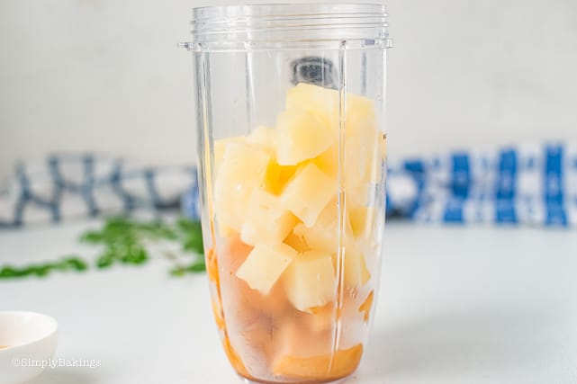 frozen bananas and pineapple chunks in a blender