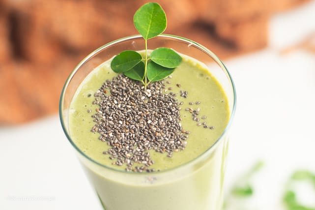 closeup of tropical green smoothie with chia seeds and malunggay leaves
