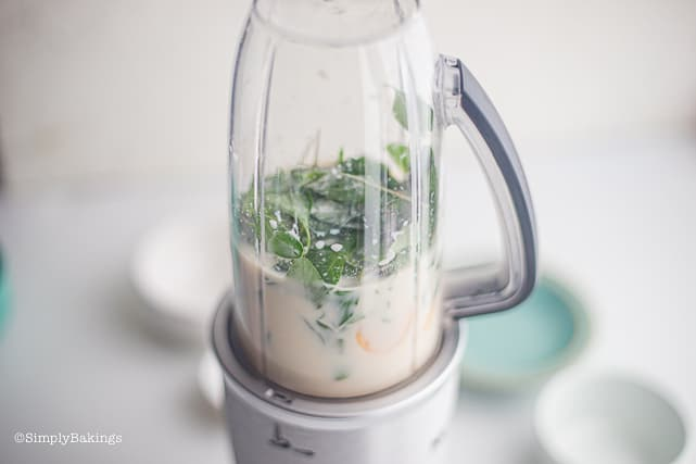 blending the ingredients of tropical green smoothie in high speed