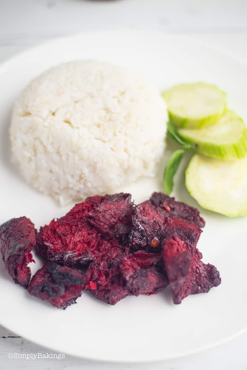 delicious Filipino Vegan Tocino with rice and cucumber slices on a white plate
