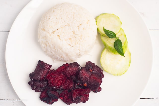 delicious vegan tocino served with rice and cucumber slices