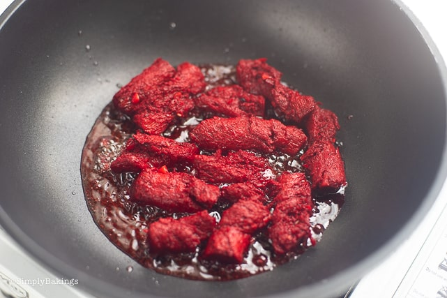 frying the vegan tocino in a deep pan
