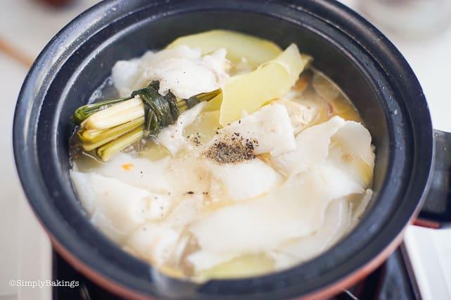 seasoning the Binakol with salt and pepper