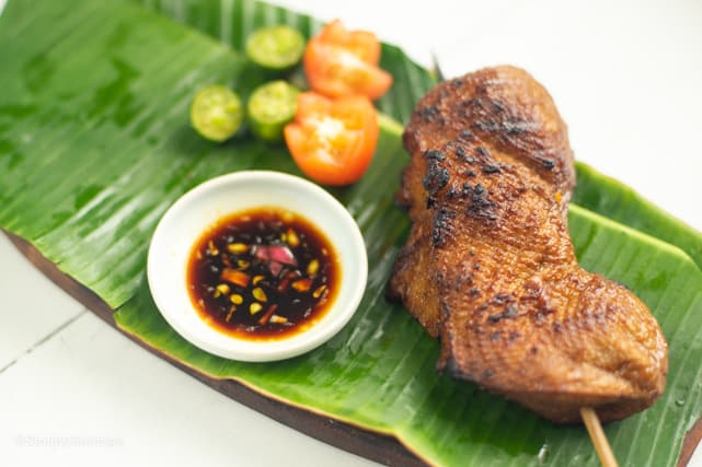 delicious vegan chicken inasal served with soy sauce, tomatoes and calamansi