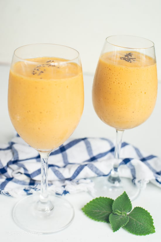 refreshing vegan papaya banana smoothie on wine glasses