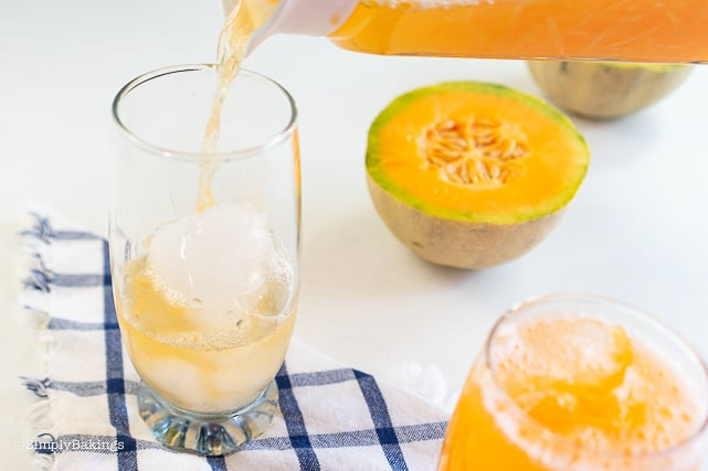 pouring cantaloupe juice in a glass