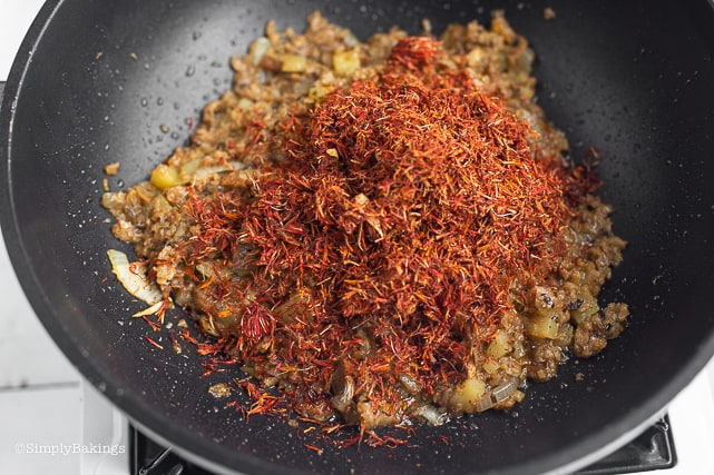adding saffron spice