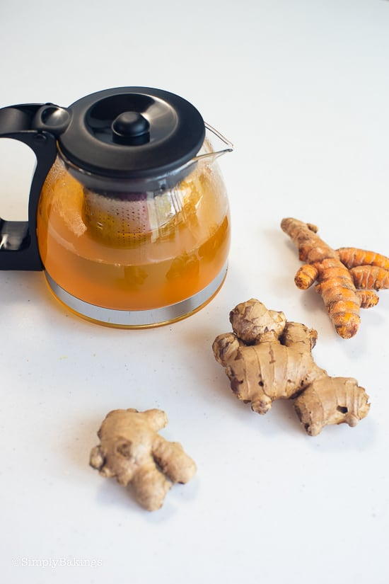 Salabat tea, ginger, and turmeric on a white table