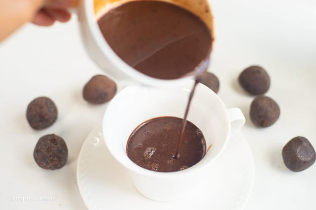pouring the cooked hot chocolate in a cup