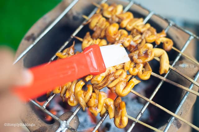 basting the vegan isaw with marinade