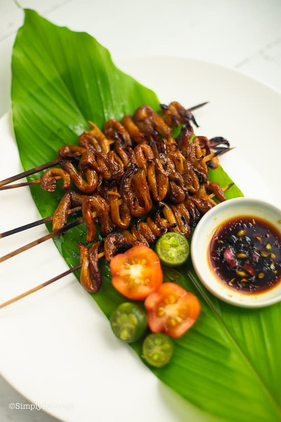 warm, grilled vegan isaw on a leaf