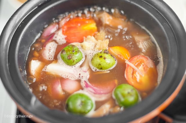 boiling cansi soup with batwan and tomatoes