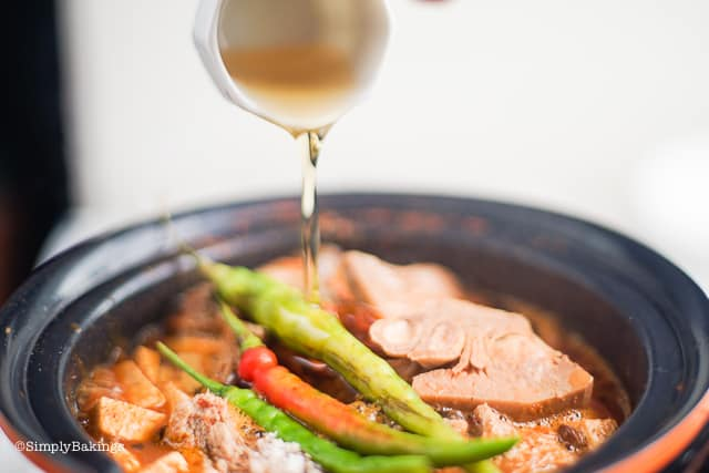 adding sesame oil to the vegan cansi