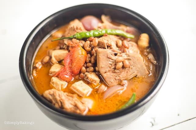 comforting cansi soup in a black bowl