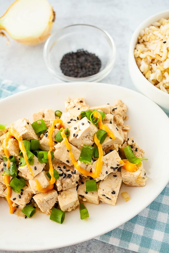 delicious tofu poke with sriracha sauce and green onions