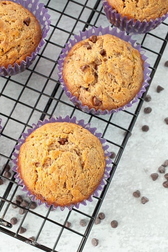freshly baked vegan banana chocolate muffins on a cooling rack