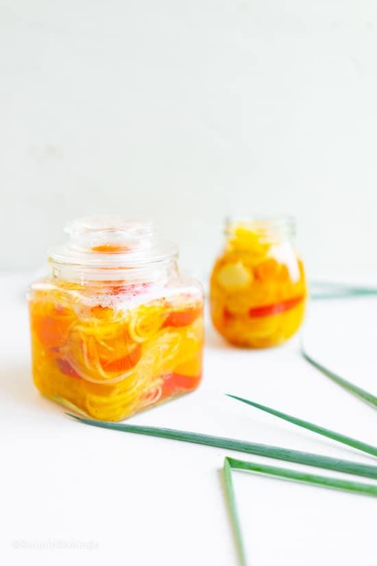 two jars of green papaya relish