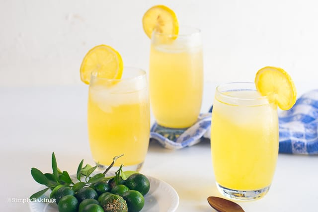 three glasses of calamansi juice with lemon slices