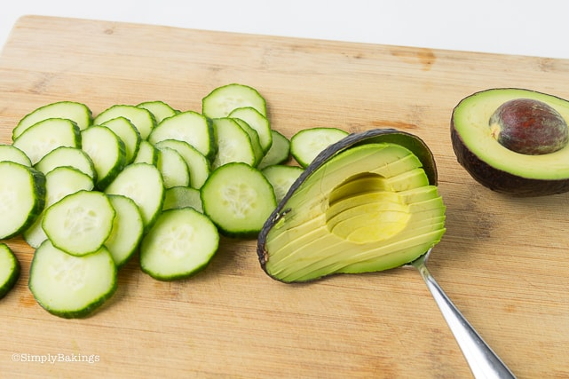 sliced avocados and English cucumber for chickpea buddha bowl