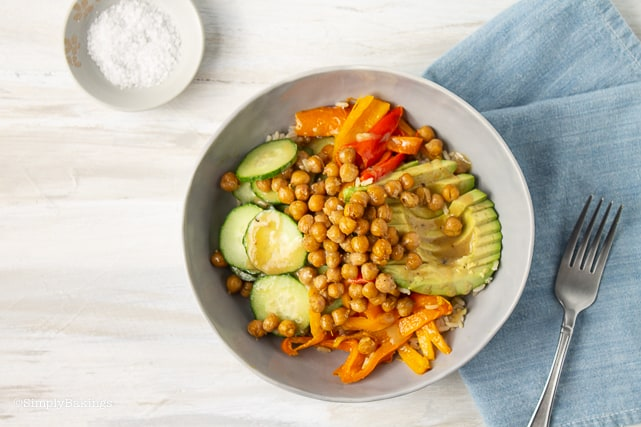 chickpea buddha bowl on a table with fork beside it
