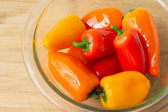 oil-coated sweet peppers in a bowl for chickpea buddha bowl recipe