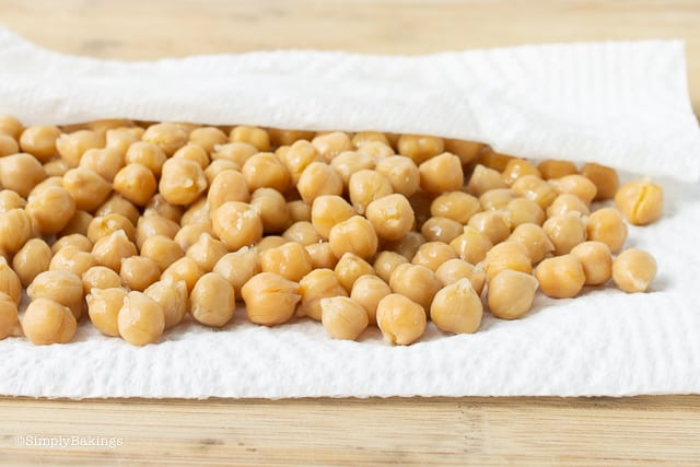 patting dry the chickpeas for chickpea buddha bowl using a paper towel
