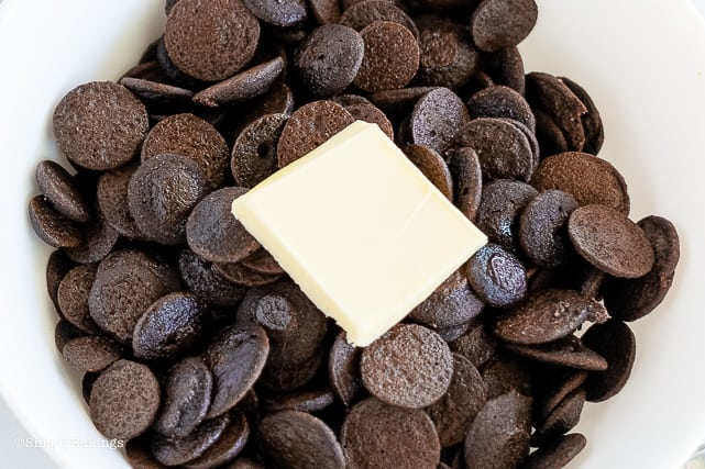 mini pancake chocolate cereal with butter on a white bowl