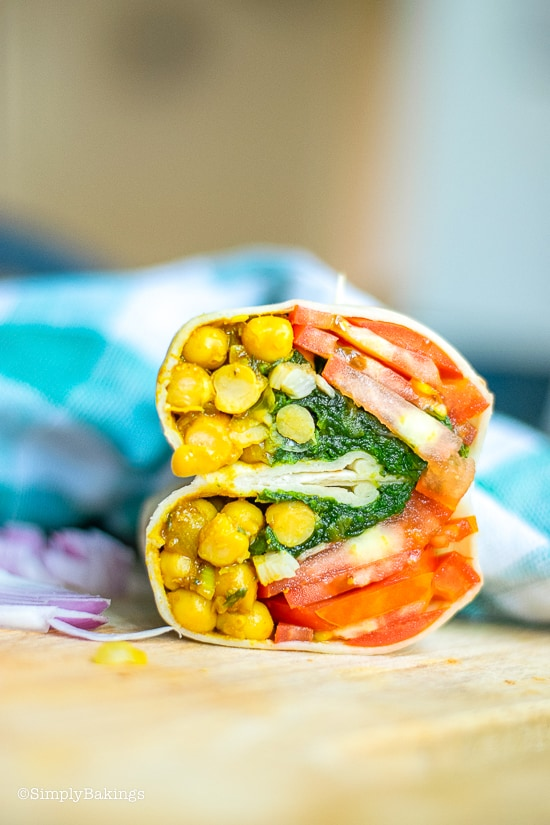 delicious curried chickpea wraps on a wooden board