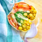 curried chickpea wraps on top of a wooden board