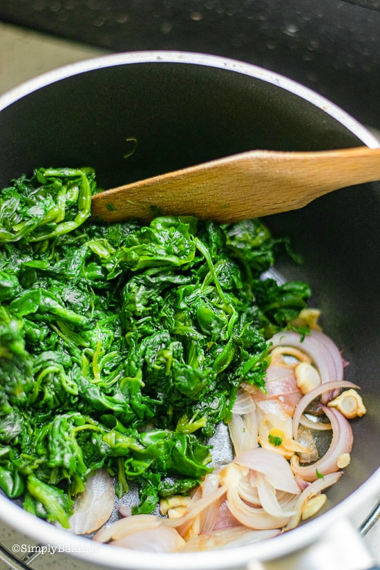 sauteing the spinach with the onion and garlic for the curried chickpea wraps