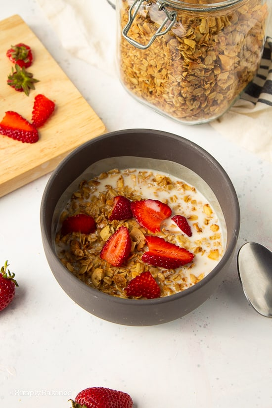 granola bowl with milk and fresh strawberries
