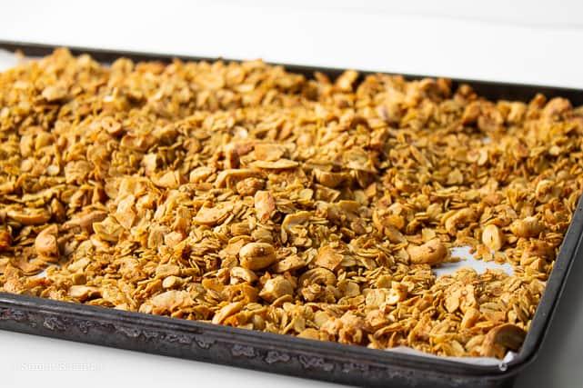 freshly baked granola in a baking pan