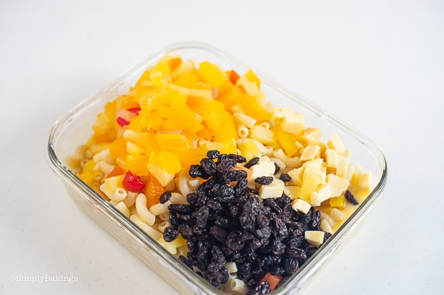 ingredients of macaroni salad in a glass dish
