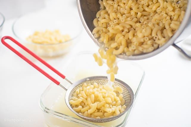 straining the cooked macaroni pasta