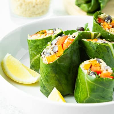 slices fo delicious vegan collard wraps in a bowl with lemon wedges
