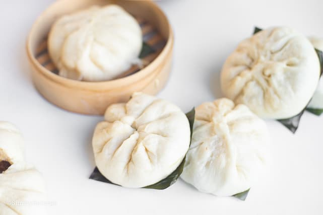 four pieces of steamed siopao