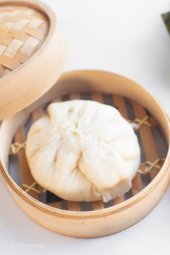 steamed siopao on a bamboo steamer