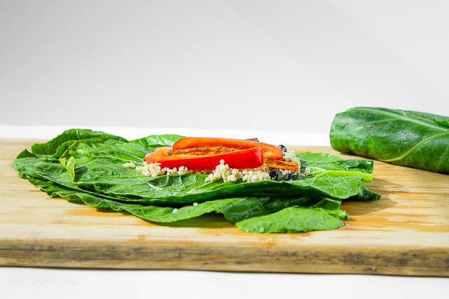 adding the nutritious filling of the vegan collard wraps