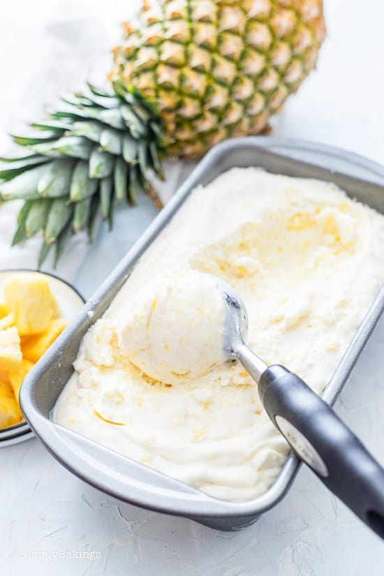 scooping Pineapple Ice Cream from the container