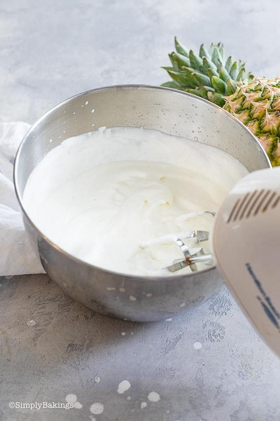 mixing the cream for the Pineapple Ice Cream recipe