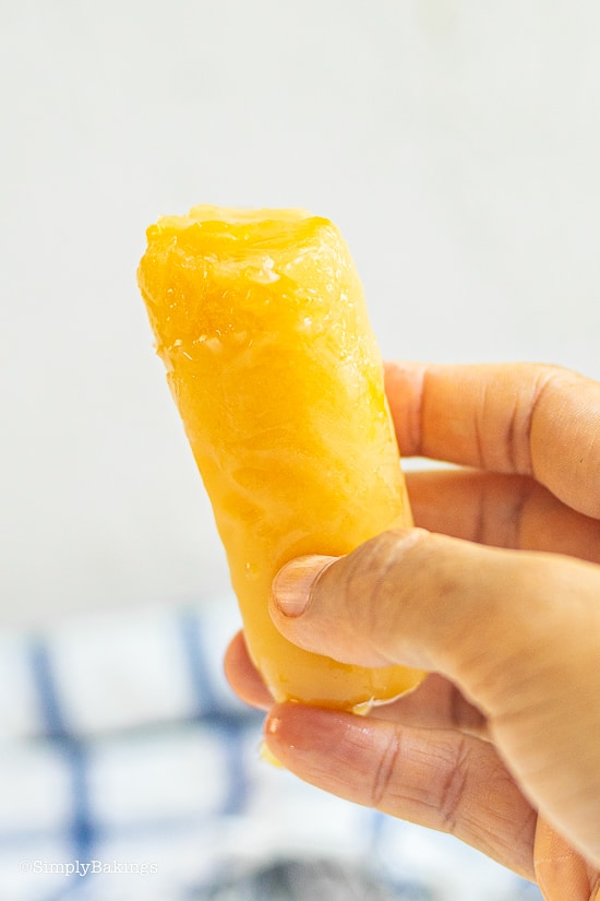 delicious Vegan Mango Ice Candy held by a hand
