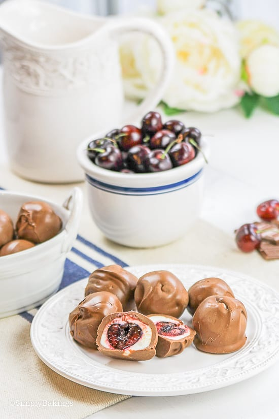 chocolate covered cherries halved on white plate